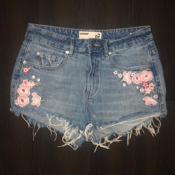 Light wash denim shorts with floral embroidery